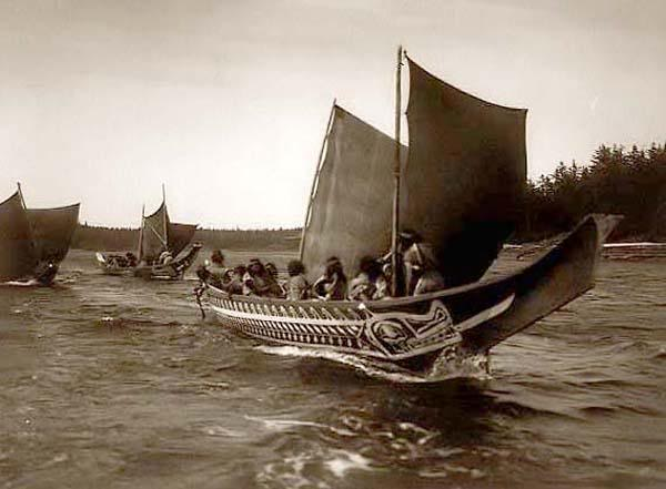 Northwest Coast canoes with woven sails.