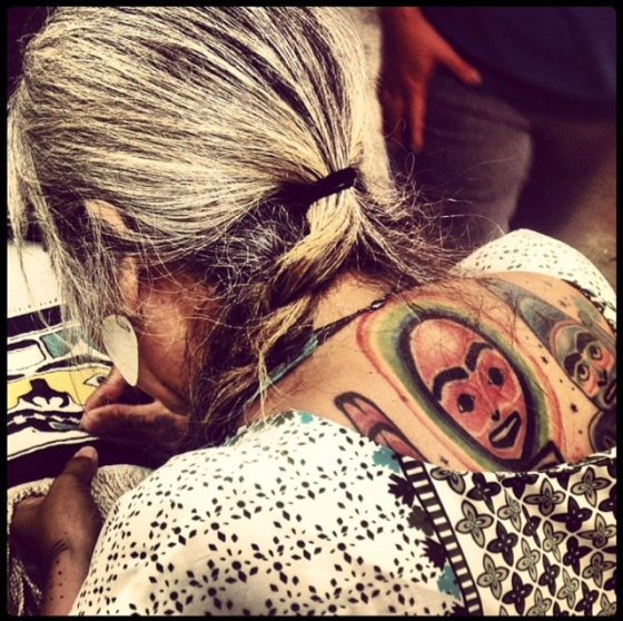 The most beautiful tattoos! Sherri looking at Pearl Innes weaving.