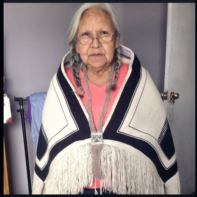 Our Haida and Kwakwaka'wakw family matriarch, Minnie Johnston, wear Salmon Berry Ancestor Pendant and Sky Blanket, 2015