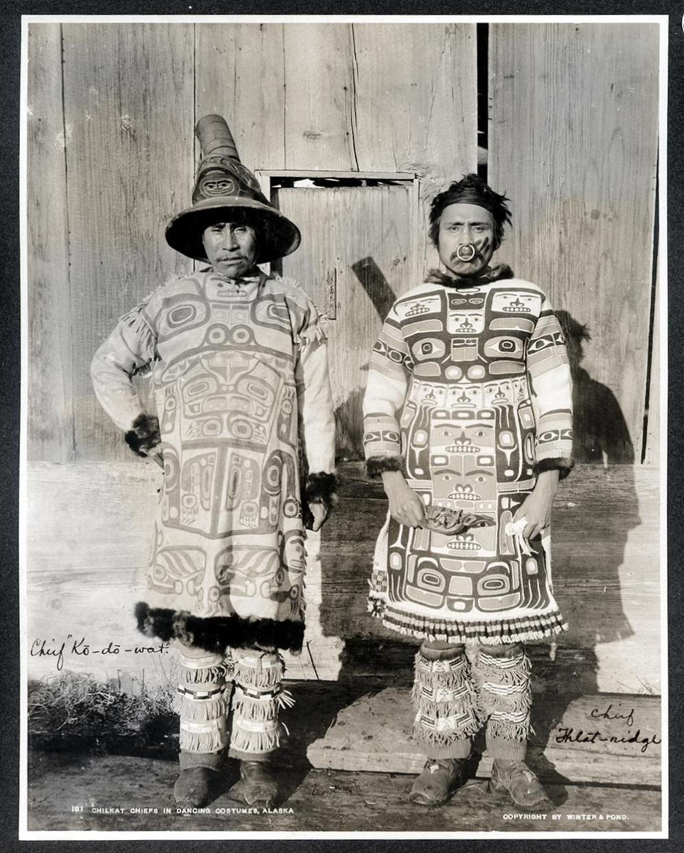 Chilkat (Tlingit) Chiefs in Dancing Costumes, Southeast Alaska. - Coudahwot and Yehlh-gouhu, chiefs of the Con-nuh-ta-di at Klukwan, wearing totemic design dance shirts and beaded leggings. Photographer: Winter & Pond, ca. 1895.:
