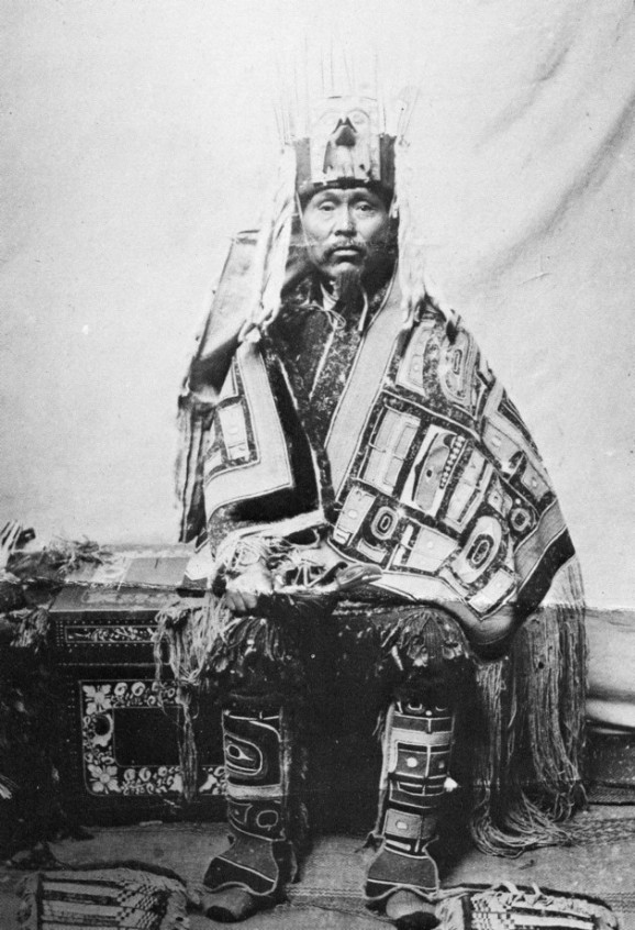 Tlingit man wearing Chilkat robe and leggings. Southeast Alaska. Courtesy of the Library, American Museum of Natural History, Jessup Collection, 411184.